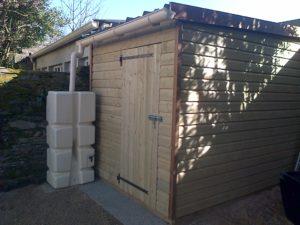 Cabanon en bois réalisé par aux 1001 Saisons pour l'aménagement extérieur d'un jardin
